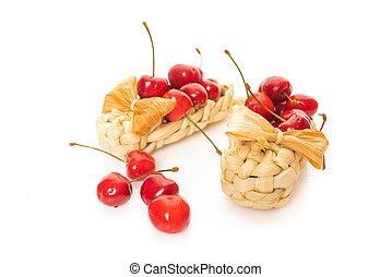 Cherry in basket isolated on a white background