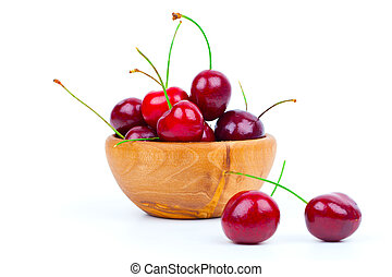 Cherry in wooden bowl isolated on white background