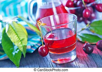 cherry juice and berries - fresh cherry and fresh juice on...