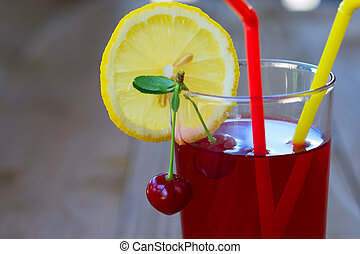 Cherry lemonade in glasses on a wooden table