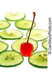 Cherry on slide lime on white background