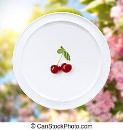 Cherry on white plate against sakura flowers