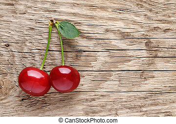 Cherry on wooden background
