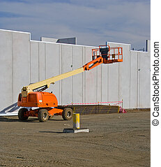 Elevated cherry picker on construction site