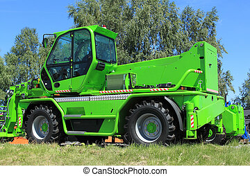 New, shiny and modern green lift machine. Construction industry machinery.