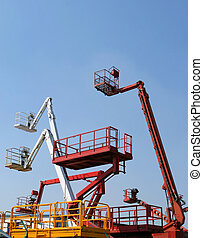 Colorful choice of cherry picker hydraulic ramps - industrial machines