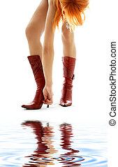 cherry red boots - picture of redhead lady hooking her boot...