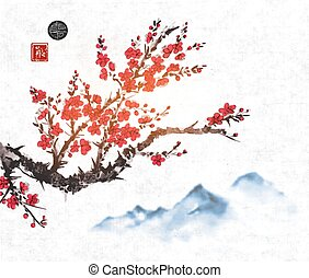 Cherry sakura tree branch in blossom and far blue mountains...