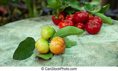 Cherry Thai or Acerola cherries fruit on wooden, high ...