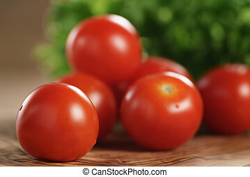 cherry tomatoes and frisee lettuce on cutting board