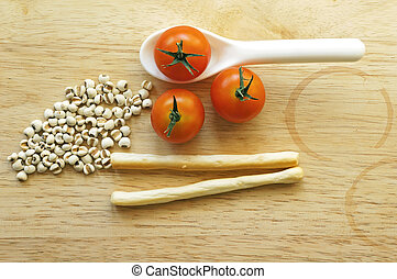 Cherry tomatoes, dried millets and stick biscuit (healthy concept)