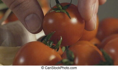 Cherry tomatoes, garlic , slow motion - Cherry tomatoes,...