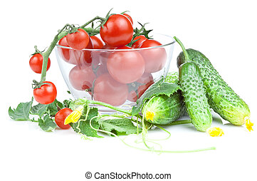 Cherry tomatoes in a salad bowl with flowers and cucumber leaves isolated white background
