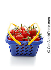 cherry tomatoes in a shopping cart, isolated on white