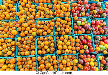 Cherry tomatoes in baskets at the market