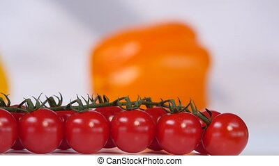 Cherry tomatoes on a background of yellow sweet pepper