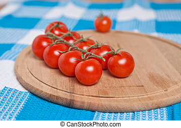 cherry tomatoes on a cutting board close up