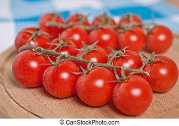 cherry tomatoes on a round cutting board