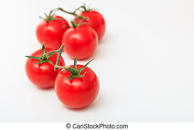 cherry tomatoes on a white background