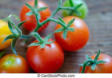 Cherry tomatoes on the wooden table