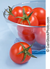 Some ripe cherry tomatoes in a glass bowl