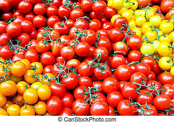 Cherry tomatoes - Bunch of small cherry tomatoes on the...