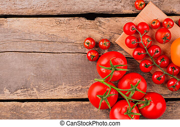 Cherry tomatoes with drops on branch.