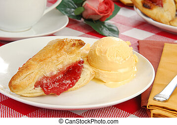 Cherry turnover with ice cream
