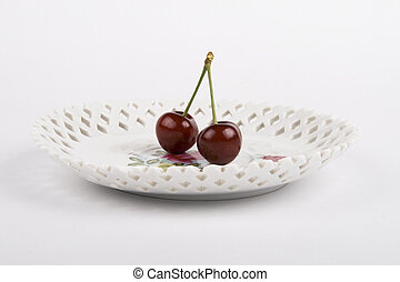 Cherrys and the plate on white background