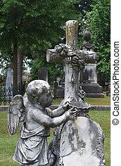 Cherub, cross, and crown monument