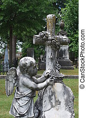 Cherub, cross, and crown monument