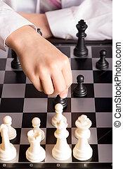 chess and hand closeup