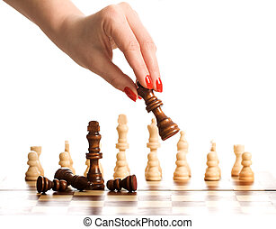Chess and woman hand