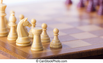 Chess board with chessmen - Close up of chessmen on wooden...