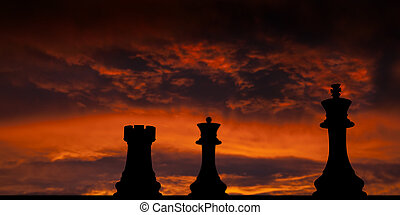 Chess checkmate over sunset background