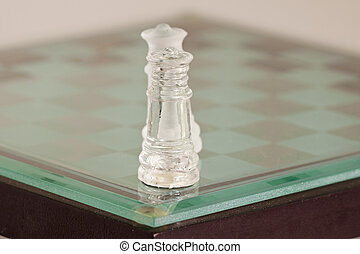 Close up of chess kings on glass chessboard