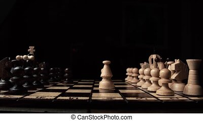 chess closeup, wooden chess board, business concept, black background. slide camera. Studio.