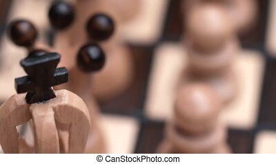 chess closeup, wooden chess board, business concept, black background. slide camera. Studio.