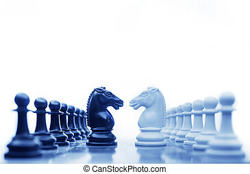 Chess conflict2 - Chess horses facing each other for a...