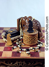 Chess, elephant and beads