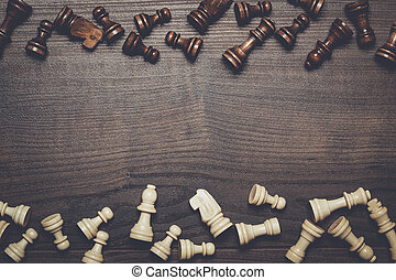 chess figures on brown woden table background