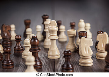 chess figures on the wooden table