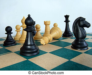 Chess game – the king is - Chess pieces on the chessboard,...