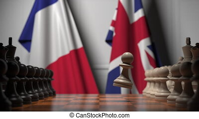 Chess game against flags of France and Great Britain - Chess...