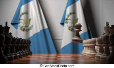 Flags behind pawns on the chessboard. Political rivalry related 3D