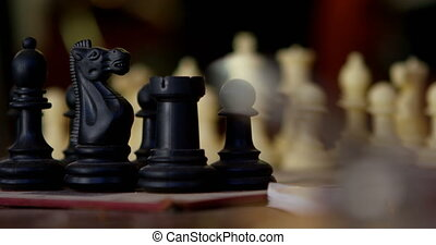 Chess game and chess pieces on table 4k - Close-up of chess...