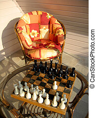 Chess game and garden chair