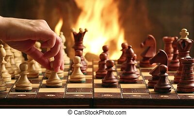 Chess game by fireplace