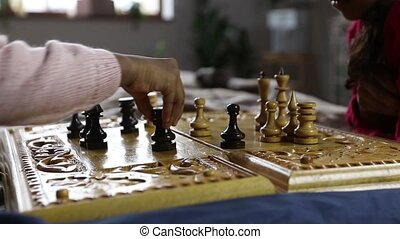 Chess game player making black rook move - Closeup little ...