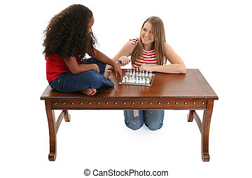 Chess Game - Young girl and baby sitter playing chess...